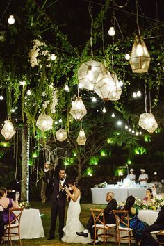 Geometric-shaped lanterns are both modern and romantic, merging abstract with nature in this set-up.