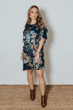 This simple viscose gown is cut to fit the neck snuggly, making the statement cold shoulder even more of a focal point. Ruffle Dress, Casual Wear, Cold Shoulder, How To Make, How To Wear, Gowns, Simple, Fit, Dresses