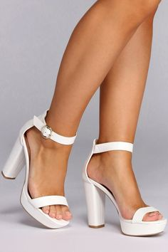 Make a next-level entrance in these white platform sandals. Heels have a single strap across the toes, a buckled ankle strap, and a stabilizing platform. Heels are made with a faux leather material and have a faux leather lining. White Bridal Shoes, Bridal Heels, Bridal Wedges, On Shoes, Wedge Shoes, Shoes Heels, Prom Heels, Stilettos, High Heels Outfit