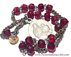 $49 Vintage French St. Anne and child Mary 6 inch long Chaplet with deep ruby red glass beads features a silvertone aluminum medal that reads Sa...