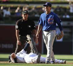 Game #114 8/8/12: Darwin Barney #15 of the Chicago Cubs reacts after Chris Denorfia #13 of the San Diego Padres slides into second base with a double during the eighth inning of of a baseball game at Petco Park on August 8, 2012 in San Diego, California. The Padres won 2-0. (Photo by Denis Poroy/Getty Images)