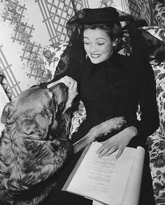 """Butch visits its mistress, Gene Tierney, on the set of """"The Ghost and Mrs. Muir"""""""