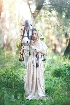 Lovely photo, dream like and pastel colours. White horse adds another element of fairy tale in the over grown green grass.
