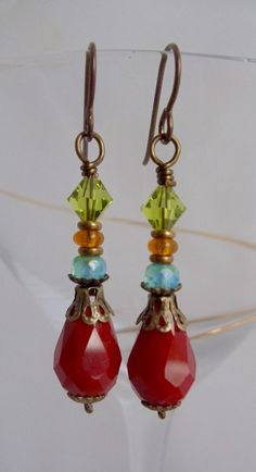 These multicolored gypsy dangle earrings are made with assorted Swarovski crystal and Czech glass beads. They are accented with brass beads