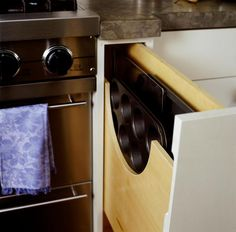 Pull out baking tray vertical drawer for smaller cupboards in kitchen (also good for larger chopping boards).  Top 10 Smart Storage Solutions for Your Kitchen