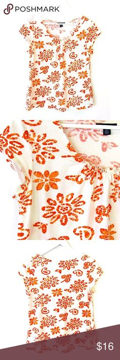 """Tommy Hilfiger Floral Knit Top Orange White Sz L Brand: Tommy Hilfger Style: Tshirt, cap sleeves, ruffled neckline Size: L Color: Orange, white daisy floral Material:100% cotton Measurements taken flat: -Across under arm: 21"""" -Shoulder to hem: 24"""" Garment Care: Machine wash, tumble dry  Condition: No flaws. Tommy Hilfiger Tops Blouses"""