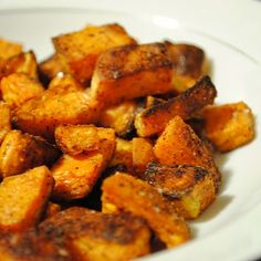 Spicy Roasted Sweet Potatoes           Here's another alternative to that traditional sweet potato pie I was talking about yesterday, but this recipe has a savory spin on it.  These are as simple as it gets, all you have to do is peel and chop the sweet potatoes.  Then it's as easy as tossing them on a baking sheet with a little olive oil and some spices.  Roasting them at a high temperature, res
