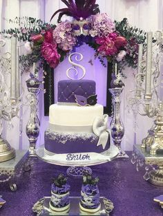Purple showstopper cake at a masquerade Quinceañera party! See more party planning ideas at CatchMyParty.com!