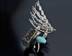 Cuff | Michael Roanhorse. (Navajo) 'Beethovan'.  Sterling silver, coral and turquoise.