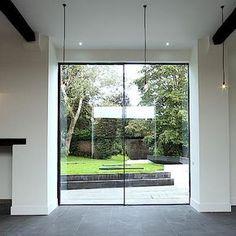 Keller Minimal Windows Are Frameless Sliding Which Create Open Living Concepts That Let In Maximum Windowssliding Gl Doorwindows