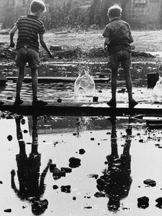 "hauntedbystorytelling:"" Shirley BAKER :: Two young boys take great delight in the splashes made by dropping chunks of rubble into a large puddle, 1964 [via Mezzaluna]more [+] by this photographer"" Monochrome Photography, Black And White Photography, Street Photography, Vintage Photographs, Vintage Photos, Shirley Baker, Street Portrait, Portrait Art, Portraits"