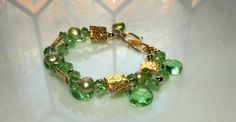OOAK Dragon Eyes Double Strand Peridot Pearl by tinboxjewels, $100.00