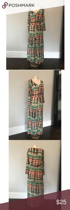 Boutique sheer maxi dress. Colorful size small Semi sheer. Beautiful pattern. Button up. 100% polyester. Cinched just around waisted for a fitted look if buttoned or can be worn open. Great for festivals, over shorts or a cute black dress. No tag but it was purchased as a small. My dress form is a size 4/6 for reference. Long sleeve. Maxi length. boutique Sweaters Cardigans