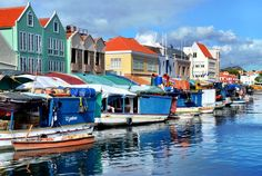 Every day in the Punda district of Willemstad, Curacao, dozens of Venezuelan fishermen arrive with fresh fish, fruits and vegetables to sell along the waterfront