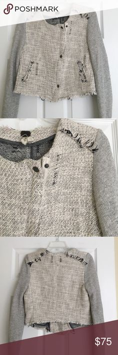 Free People cotton tweed moto jacket The must have for fall! Authentic and gently worn moto jacket from Free People . This is from the 'We the Free' line . It's has a light grey tweed body, asymmetric zipper with snaps and grey unfinished sweatshirt sleeves ! It would look great with some dark skinnies and boots! Small pink mark on the inside of the jacket. 100% cotton. 22 inches long. Free People Jackets & Coats