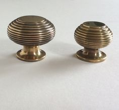 Cupboard knobs, heavy brass antiqued finish . 40 and 30 mm diameters