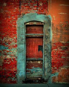 orange brick blue door