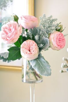 Small cabbage rose, kochia and dusty miller arrangement in a pedestal vase by Sebesta Design