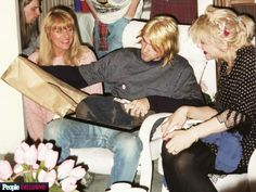 Kurt Cobain with his wife Courtney Love and his mother Wendy O'Connor, 1992
