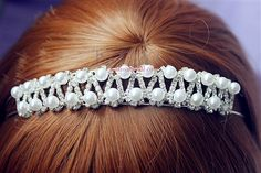 A sparkly rhinestone crystal bridal tiara. It makes an elegant bridal halo, wreath or crown, with a silver wire band for styling convenience. - Karmabridal.com