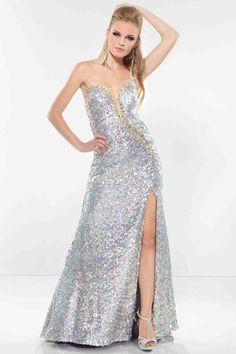 Glitter all over in this glam gown from Riva Design R9617. This strapless sweetheart dress is shimmering all over with sequins. The dress shows off your curves and has a unique cut out that drifts from the bust to the hips. It's lined with flashy gems and draw the eye over your entire body. http://www.trendycollection.com/riva-design-prom-item-23593&category_id=0&pagenum=1&click=brandsclr&filterby=onsale
