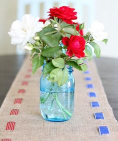Dress up your table with a super-easy, no-sew table runner. Cut slits in the burlap to weave in red and blue ribbons. This vintage, Americana-inspired craft is festive enough for a 4th of July party, but not so flashy that you can't use it for other celebrations.