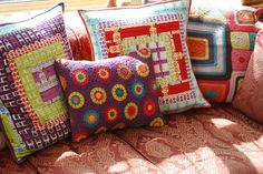 Cushions by Tracy at the Dragonflies blog. - I specially like the purple crochet cushion! @Nell