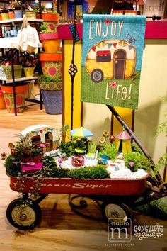 """Gypsy Garden"" by Genevieve Gail for Studio M. Miniature Garden Wagon and Vintage Camper Display at the Atlanta Mart Showroom. @mworksltd @genevievegail"