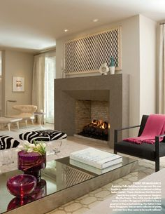 The fireplace facade takes centre stage with pops of pink, zebra print, modern art price and a soft palette = gorgeous & cleverly conceived.