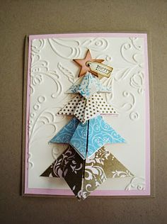 Origami Christmas Tree. With video. Would love to try and make this with old Christmas cards - wouldn't that be pretty?