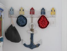 Nautical baby room, nautical boys bedroom, baby boy bedroom ideas, nautical baby room idea, blue baby room, blue baby boys room, how to decorate a baby room, anchors in baby room, navy and white baby room, scatter cushions, boat mirror, nautical decor ideas, baby room decor ideas, whale scatter cushion, nautical baby hat