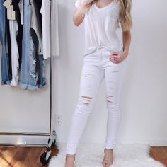 """Restocked! White Ripped Skinnys Back in stock! Get your size before they sell out again ▫️A must-have this season. LOVE. Ripped skinny pants with a premium look and feel. Most flattering fit, stretches to hug the body. 5 pocket. Flattering high rise. 9.75"""" rise and 30"""" inseam (taken from the size 3). Cotton/poly/spandex blend, soft and stretchy. New with tag. I am modeling the size 3 which fits me true to size. 0,7,13 available. Only one left in each size. Boutique Pants Skinny"""