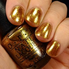 OPI Goldeneye Swatch - Look at that wonderful color. I love gold polish. Also that is a man modeling it. I wish more men were open to makeup and beauty- if only so they would cover up their zits! Lol. But seriously, it could be a fun thing for women and men to bond over. Or men and men. Point is, today is it pretty much just a woman to woman thing, and it doesn't have to be.