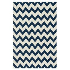 Bring a pop of pattern to your living room or patio with this chic rug, showcasing a chevron motif in ivory and ink.   Product: Rug