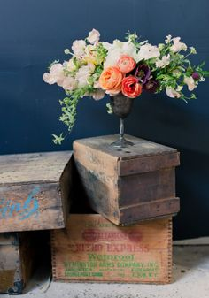 Flowers and greenery arranged in a tarnished goblet   Poppies and Posies