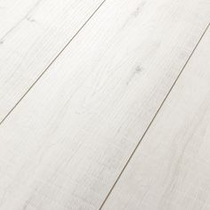 Kronotex Villa Gala Oak White is a 12mm white laminate flooring. It is a slightly whitewashed color