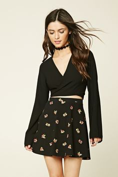 A knit skater skirt featuring a floral print, elasticized waist, and a flared…