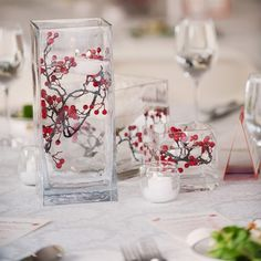 Floating Votive and Berry Centerpieces  -- perfect, simple touch for my winter wedding!