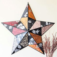 look mom! We can do the one we found by the dumpster!!  Turn a Metal Star into Photo Decor. turn an inexpensive metal star into a showcase for favorite photos; spray-paint star, create vellum patterns of each point, attach cutout shapes from photos or patterned paper. #crafts #star #decor