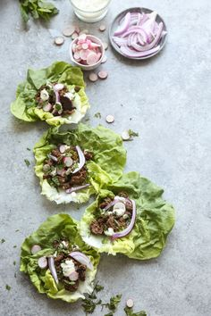 This healthy lettuce wrap recipe makes a ras el hanout spiced Moroccan lamb the star of the plate. It's fast, gluten-free, whole30, paleo and delicious.