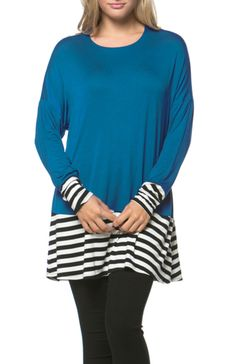 - 95%Rayon 5%Spandex - MADE IN USA - This cool and comfortable top features a scoop neckline, long dolman style sleeves, relaxed fit, and striped hemline panel. - Our Long Dolman Sleeve Tunic W/ Strip