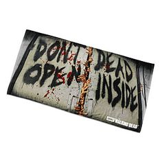 """This Walking Dead bath/beach towel reads """"Don't Open Dead Inside"""" with hands coming out the middle. So if you're using it on a beach before the zombie apocalypse, you pretty much don't have to worry about anybody messing with your stuff."""
