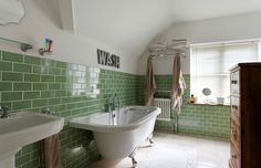 Love the schoolhouse tile and the towel-dryer/warmer radiator- desiretoinspire.net