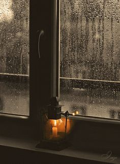 GIF of rain softly hitting window pane and of a realistic flickering candle in a lantern ... I love this