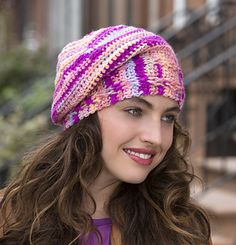 Crochet an easy hat with this bright yarn! The slouchy fit and cabled band makes it fashion right and perfect for any age.
