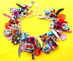A Frida Kahlo Day of The Dead charm bracelet with handmade skulls by Leandra Holder