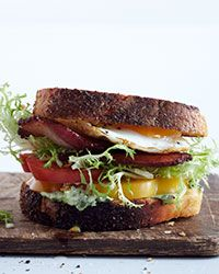 Fried-Egg BLTs with Arugula Aioli Recipe on Food & Wine ~ Reinvented Classic: Chicago chef Jimmy Bannos, Jr., improves on the classic BLT by layering his version with curly frisée, lemony arugula aioli, thick-cut bacon and juicy heirloom tomatoes. He tops it all with a runny fried egg.
