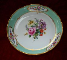 Beautifully painted with 9 reserves of flowers with a center reserve of large Meissen flowers..  In very good condition  with a small restored chip on