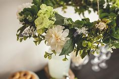 We heart hanging wedding decor, & more than that we heart hanging flowers, so we created this gorgeous silk floral chandelier DIY for you babein' brides-to-be!