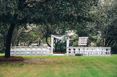 Serene Occasions Aspen Arbor with white chairs makes an elegant wedding on the green at Draper Lake in Santa Rosa Beach, FL